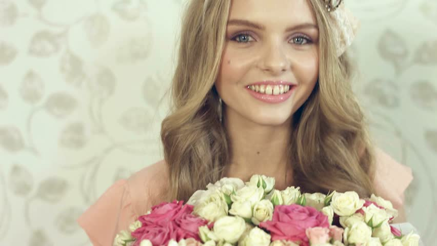 Gentle young woman with beautiful big bouquet at photosession #15809818