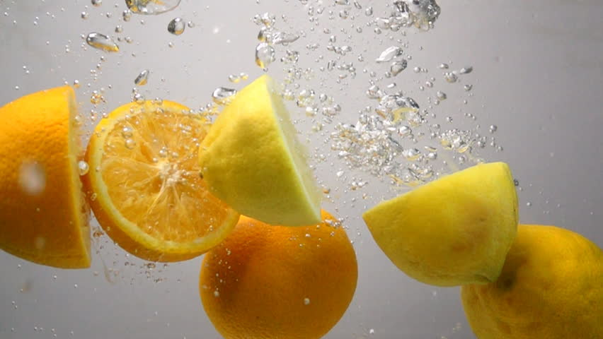 Lemon and orange drops into water in slow motion #15813367