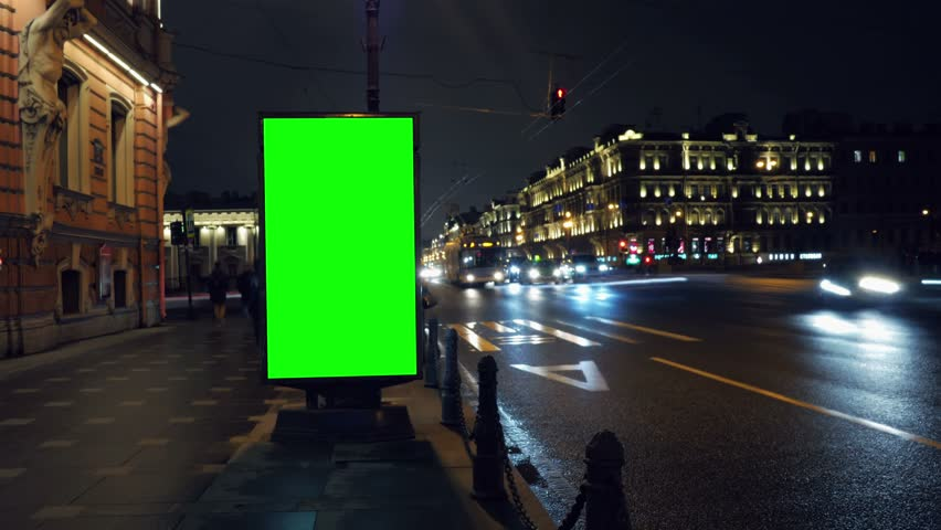 A Billboard with a Green Screen on a Busy Night Street.Time Lapse.   Shutterstock HD Video #15819571