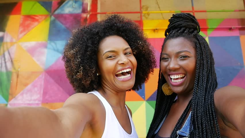 Young Afro Brazilian woman smiling for a selfie