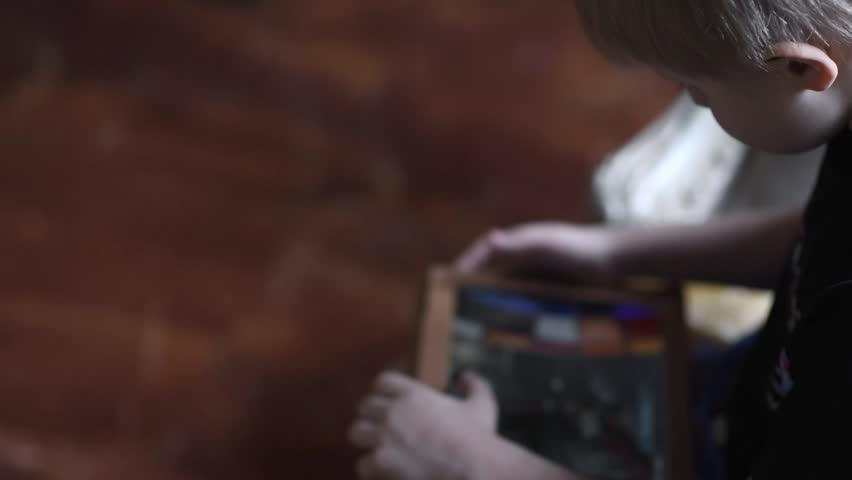 Boy playing game on tablet  | Shutterstock HD Video #15848068