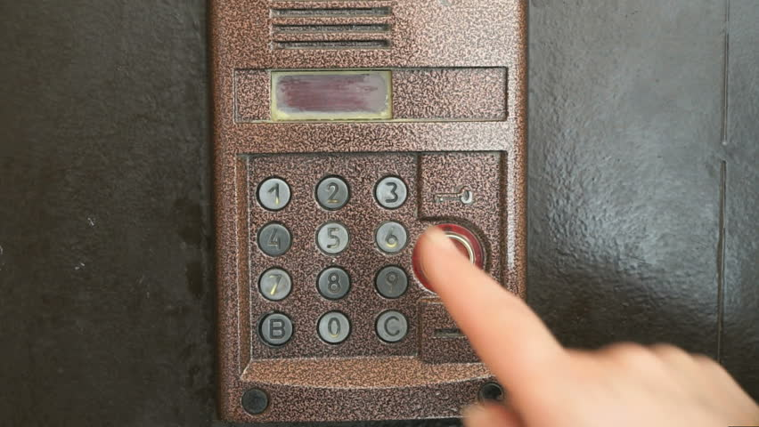 Finger dials apartment old intercom system number | Shutterstock HD Video #15880390