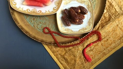 Arabian dates, fresh fruits and Islamic rosary. A healthy food for braking fast during holy month of Ramadan. Top panning shot video stock clip.
