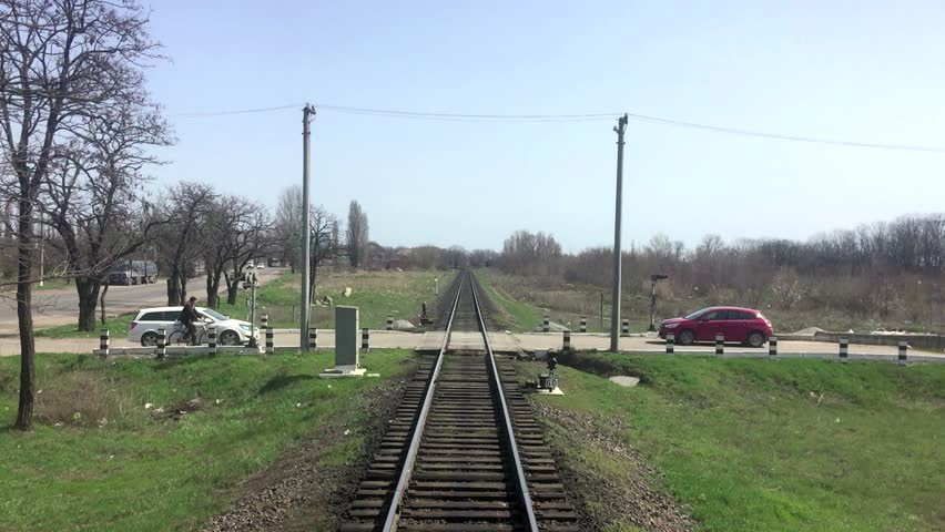 Railroad tracks stretching into the distance, the view of the last car of train | Shutterstock HD Video #15910918