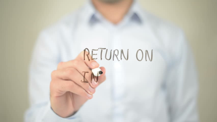 Return on Investment, Man writes on Transparent Screen