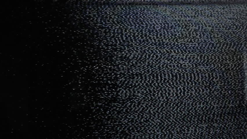 Waves of static grainy noise from an old analog tv screen. Bad signal, weak reception, digital pollution. Real footage.