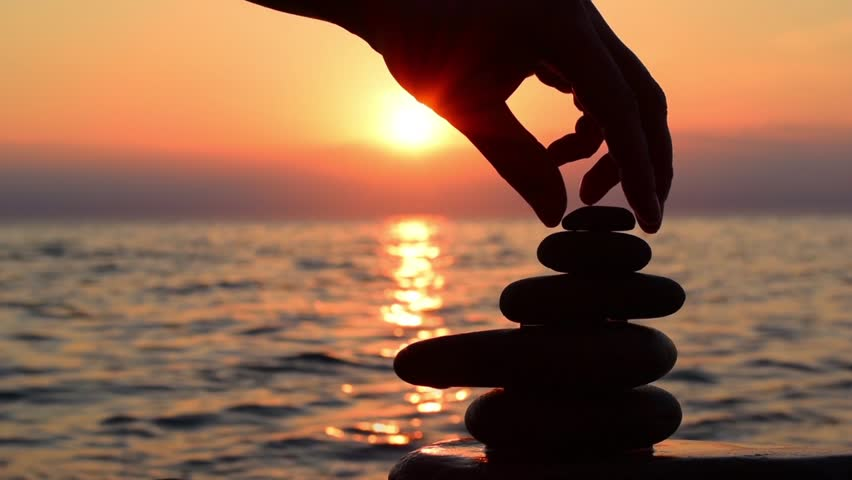 Beach sunset, man build zen symbol from stones on the beach at background of sea and gold sunset, silhouette on the beach. Beach sunset, relax, harmony, balance concept. Hull hd video. | Shutterstock HD Video #15961801