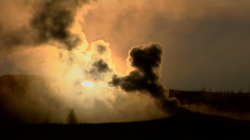 Dark clouds rise from a volcanic eruption in a geothermal area of Yellowstone National Park