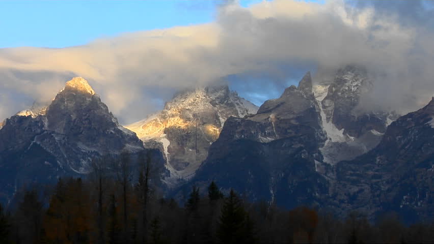 Clouds move across the Grand Teton mountain range
