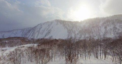 Aerial View of Orange Light Sunrise in Japanese Mountains - Niseko, Hokkaido, Japan