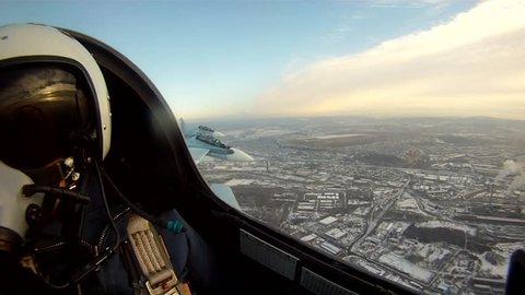Russian Military Airplanes performing aerobatics maneuvers. Cockpit camera view