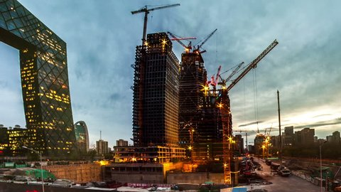 China Zun, is a supertall skyscraper under construction in the Central Business District of Beijing. One of many construction sites in Beijing. Timelapse.