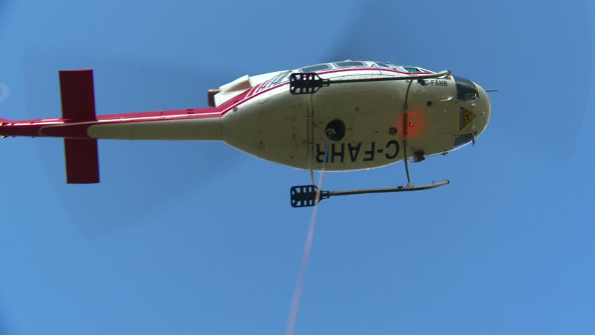Helicopter, huey overhead and descend