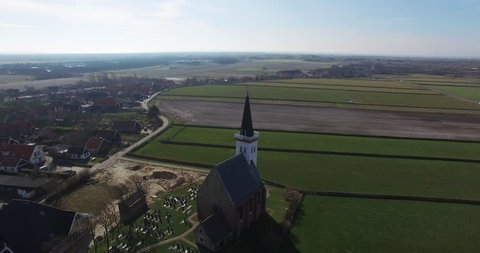 Dutch Landscape with beautiful church building aerial bird view small village Den Hoorn Texel Holland The Netherlands