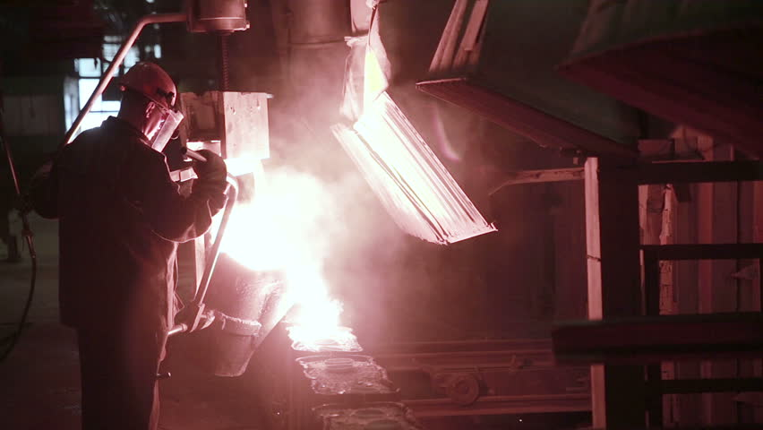 Worker in foundry controlling iron smelting in furnaces. #16169938