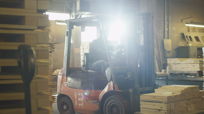 Forklift operator is driving in lumber factory warehouse shot on forklift operator is driving in lumber factory warehouse shot on red cinema camera in 4k publicscrutiny Image collections