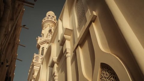 Beit Al Quran, Hoora, Bahrain. Pan right/left worm's eye view of the minaret and architecture of the fa\x8Dade of the museum.
