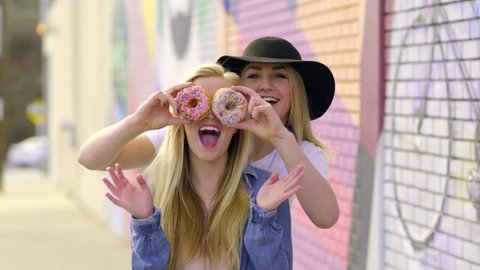 Fun Teens Pose With Donuts, They Cover Their Eyes And Make Funny Faces, And Hold Up Peaces Signs And Give Thumbs Up