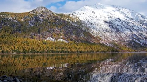 Lower Multinskoe lake in the Altai Mountains at late Autumn with snow on mountains, Siberia, Russia