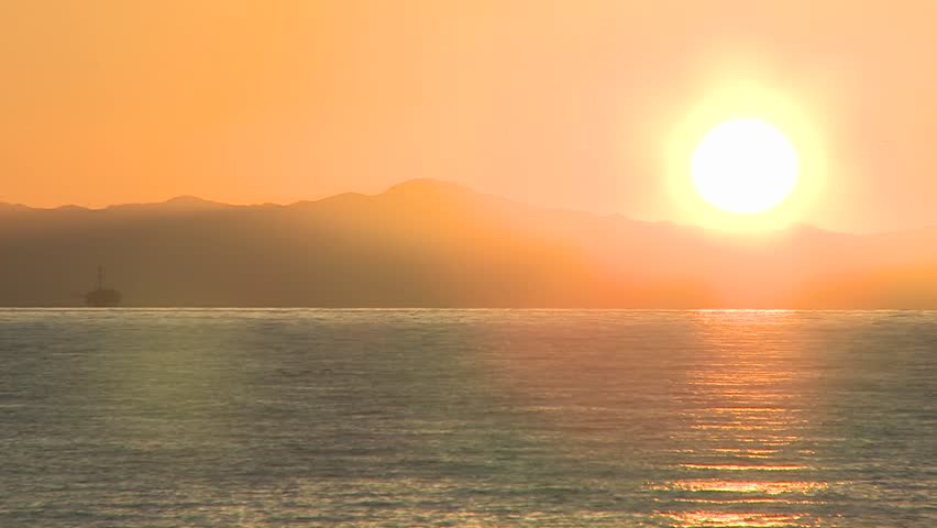 Close-up time lapse of sun setting over the Channel Islands and the Pacific Ocean at Ventura, California.