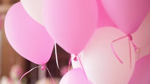 The elegant wedding or birthday dinner table with ballons, close up