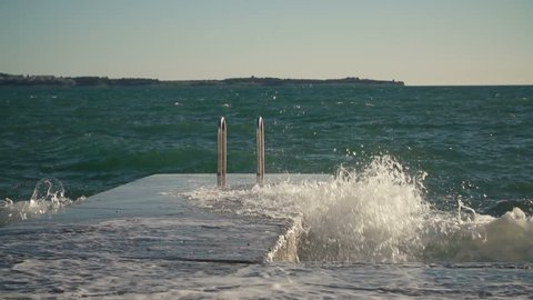 High waves hitting the city beach shore.