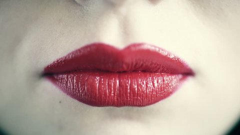 Closeup of female lips blowing kiss