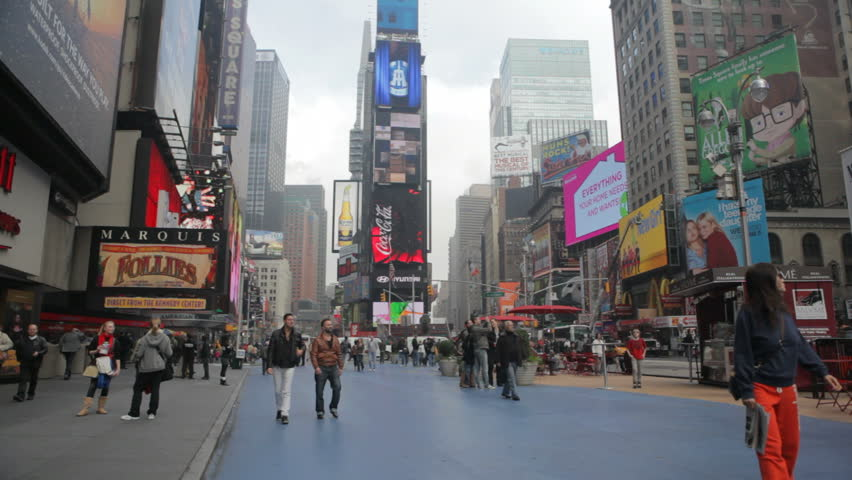 TIMES SQUARE, NEW YORK, NEW YORK - NOVEMBER 10 2011 -  Tourists in New York's Times Square see the signs and sights on a fall morning in November, 2011.