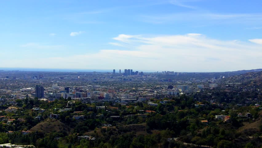LOS ANGELES, CA/USA: March 12, 2014- Westward view across Hollywood to Beverly Hills, California. This clip features a spectacular view looking down over the city from Griffith Park observation deck.
