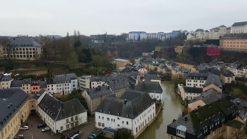 Luxembourg City, Luxembourg – winter 2016. Grund district on Alzette river with view of Neumünster Abbey. Abtei Neimënster or Abbaye de Neumünster is a famous cultural centre in Luxembourg