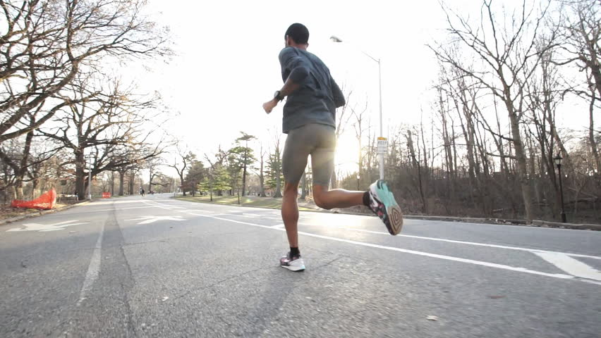 A close-up of a black male running through the park. New York, NY - March, 2016 | Shutterstock HD Video #16336648