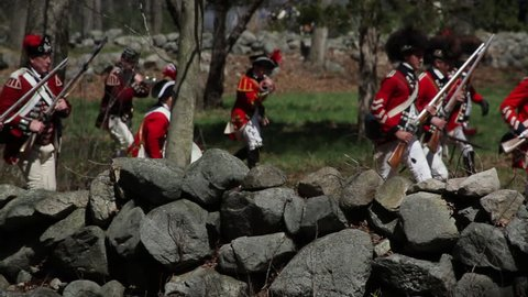 NEW ENGLAND - APRIL 2015 - Reenactment, large-scale, epic American Revolutionary War anniversary recreation, midst of battle.  American Minutemen soldiers fight, Battle Road, Lexington & Concord, MA.
