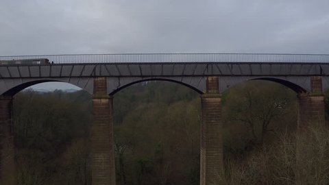 AERIAL: Pontcysyllte Aqueduct - Lifting & Tracking a barge as it crosses the aqueduct.
