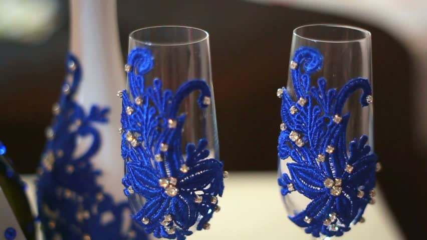 decorate champagne glasses. Empty two champagne glasses beautifully decorated for wedding celebration  Wedding decor HD stock Decorated Champagne Flutes On Table During Footage Of