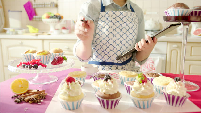 woman counting ready cup cakes shot of focused woman counting out of focus