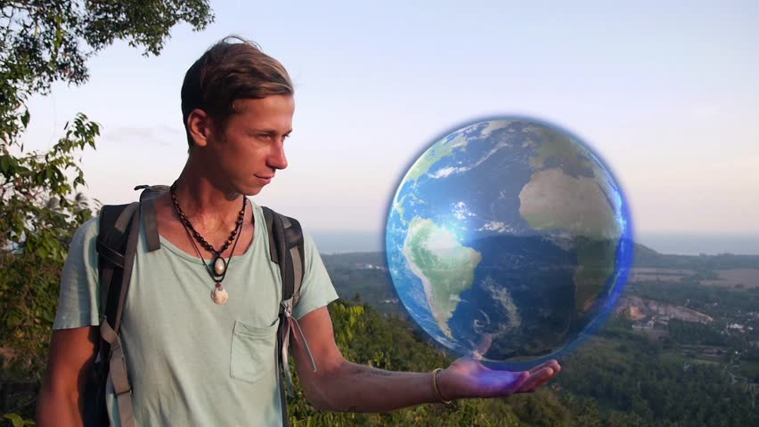 Traveler Holding Hologram Earth in Stock Footage Video (100% Royalty-free)  16388398 | Shutterstock
