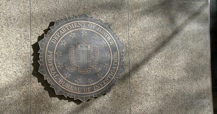 WASHINGTON DC, USA -CIRCA 2014 : FBI symbol on front of headquarter building  in downtown Washington DC.