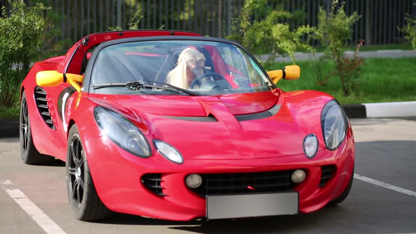 Lovely Blonde Woman Sits In Modern Red Sport Car At Sunny Day   HD Stock Video Clip Amazing Pictures