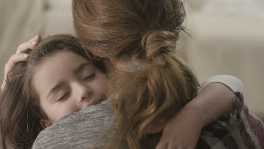 Daughter rushes into mother's arms at home and gives her a big hug. Shot on RED EPIC Cinema Camera in slow motion. | Shutterstock Video #16444624