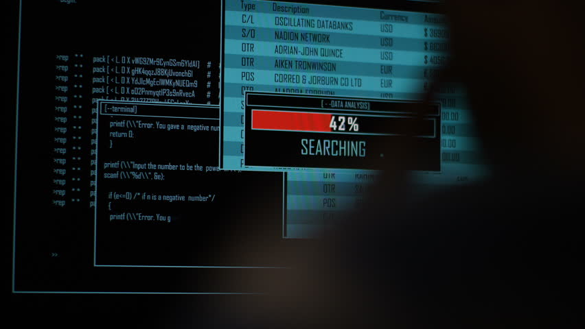 4K Hacker accessing and searching data files at night in the dark
