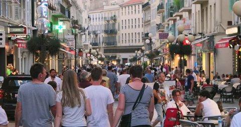 Nice France Europe 14 Jul 2015: people at old town european city street. European french riviera travel, tourism. Bastille day celebration. Mediterranean cafe, restaurants. Urban landmark architecture