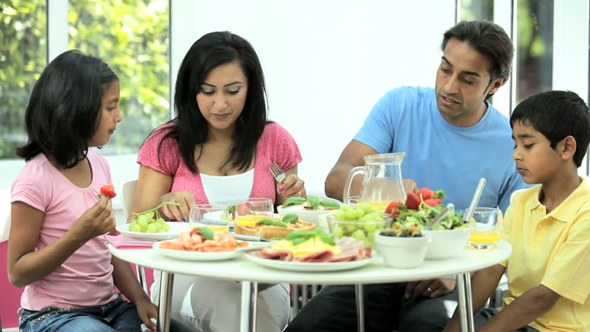 Attractive Young Caucasian Family Eating A Healthy Meal