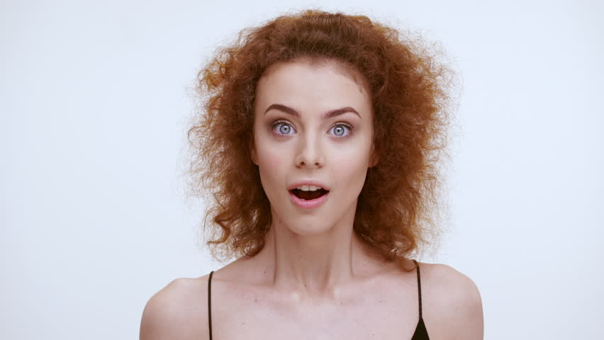 Beautiful redhead girl showing different emotions. Close up. Slow motion #16609018