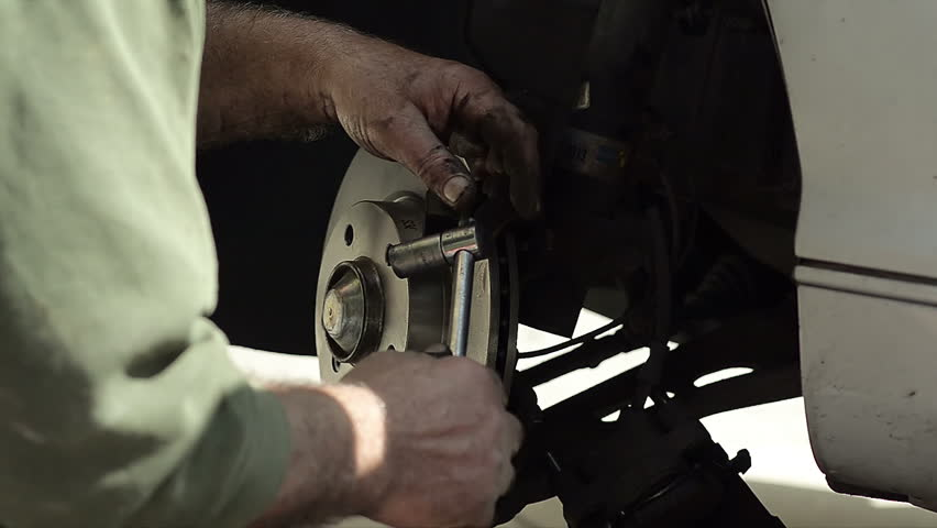 Close Up of Mechanic Changing New Brake Disc by Car | Shutterstock HD Video #16619458