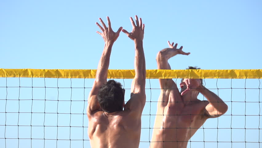 Men playing beach volleyball. - Super Slow Motion - Model Released - 1920x1080 - Full HD - filmed at 240 fps