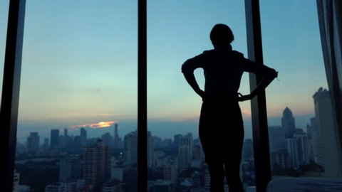 Young businesswoman admire cityscape at night, slow motion