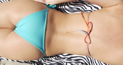 Sexy girl with a topless bathing with Brazilian Bikini
