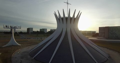 Brasilia aerial circling wide around the Cathedral occulting then revealing rising sun