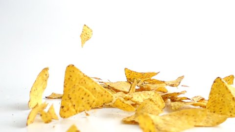 Falling Nachos against white background. Shot with high speed camera in slow motion.