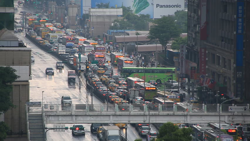 Taipei, Taiwan - May 08, 2016 : Cars and motorbikes driving on the road